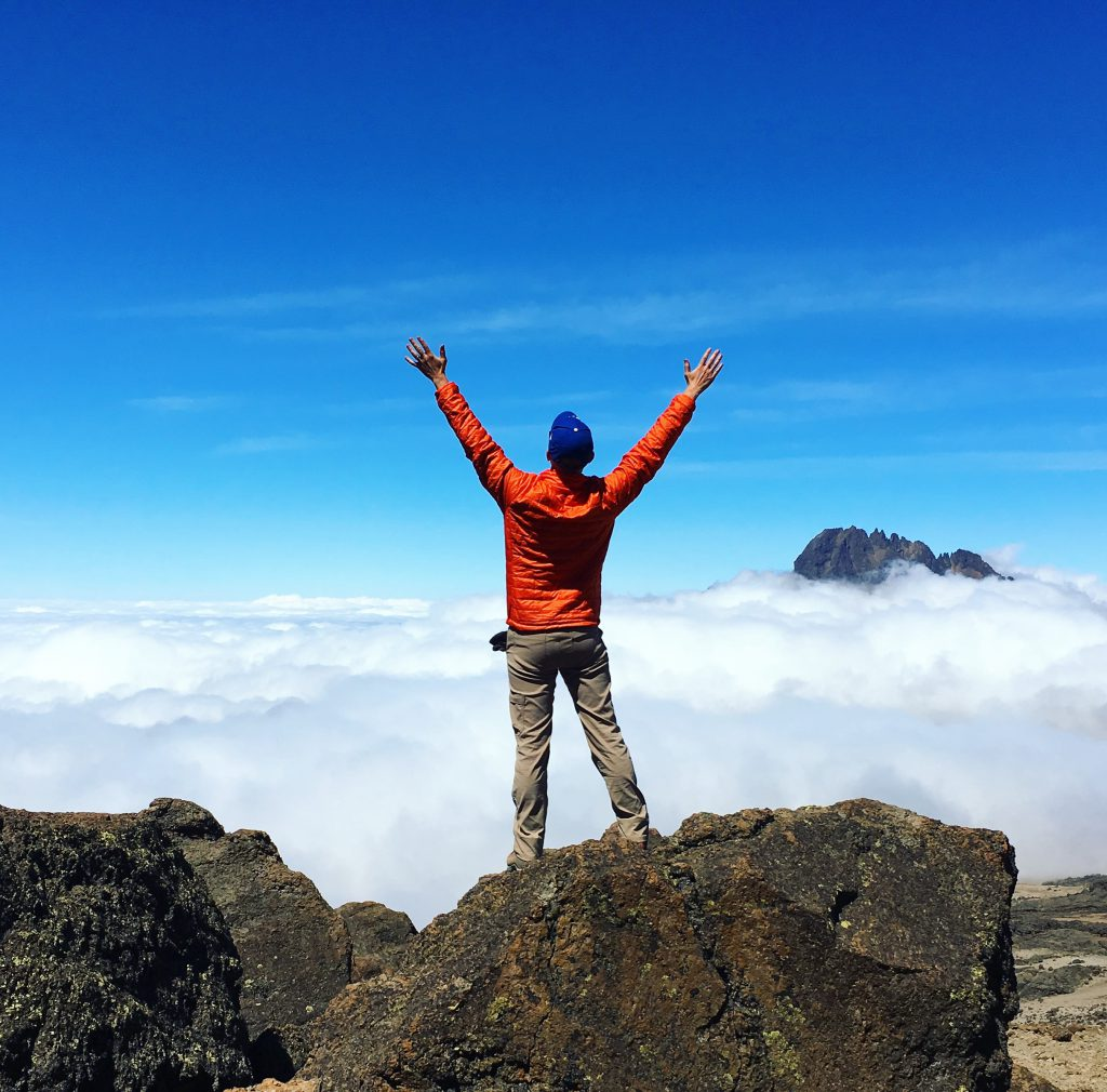 Chad Concelmo at one of the peaks of Mt. Kilimanjaro